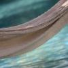 Hamac sur arrière plan de piscine, Hacienda San...
