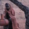 Asleep Himba girl beating butter, Otjiheke,...